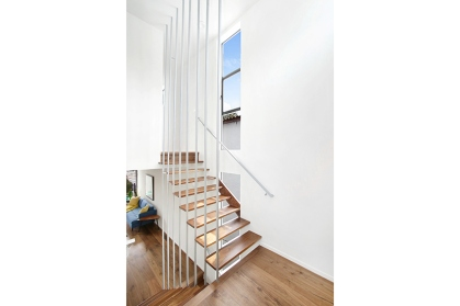 Custom designed stairway is a focal point in the home.