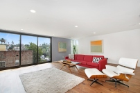 The expansive den has potential to be many things including a large studio or television viewing room.