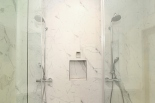 Floor to ceiling Italian ceramic marble tile, two rain shower heads with hand wands, and a Kohler steam shower in the Master Bedrooms.